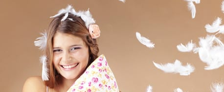 Smiling girl holding a pillow